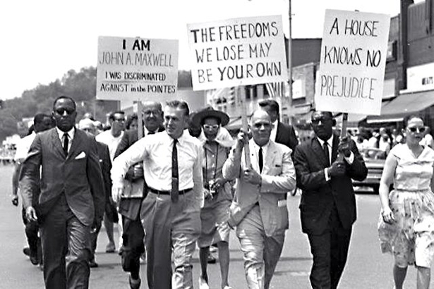 How far have we come: IN June 1963, George Romney, father of losing Presidential Candidate Mitt Romney, marches for civil rights with in Detroit.